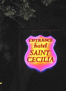 This psychadelic sign marking the entrace to Hotel St. Cecilia is representative of the dark, yet vibrant feel inside the property.