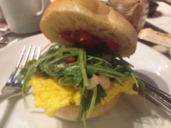 Public House breakfast sandwich with scrambled eggs, arugula, and roasted tomatoes.